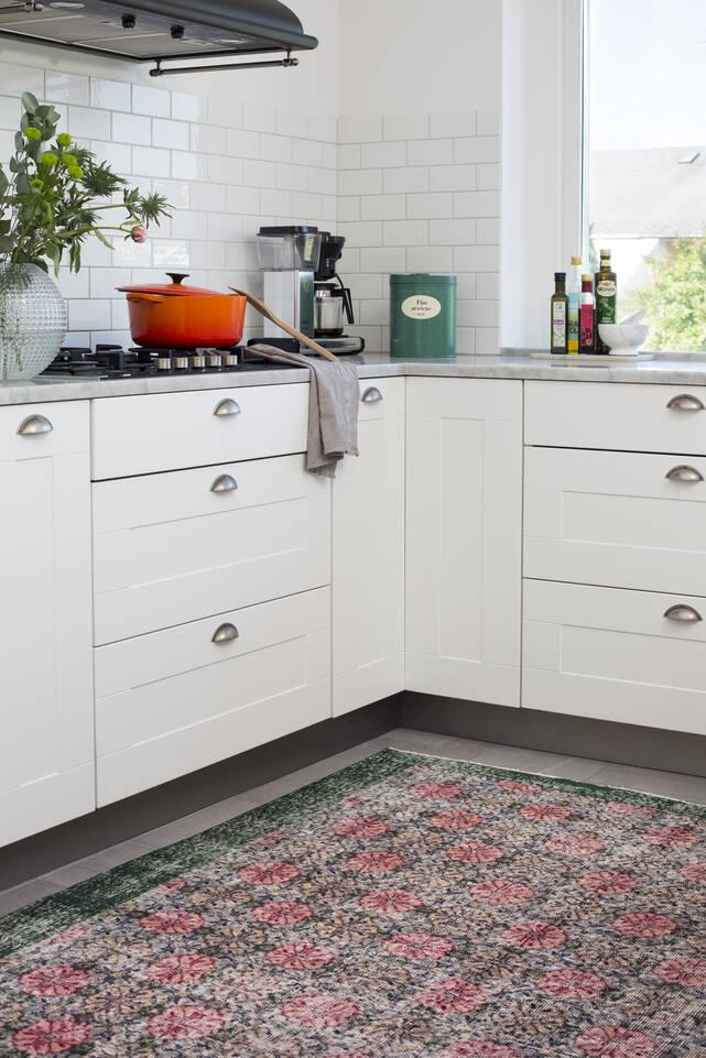 Pink  colored vintage - turkiet -  Carpet in a kitchen.
