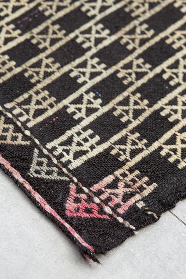 Black / grey  kilim semi antique turkish -  Carpet in a kitchen.