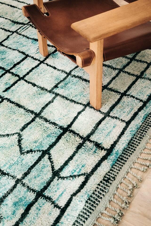 Green  berber moroccan - mid atlas -  Carpet in a living room.