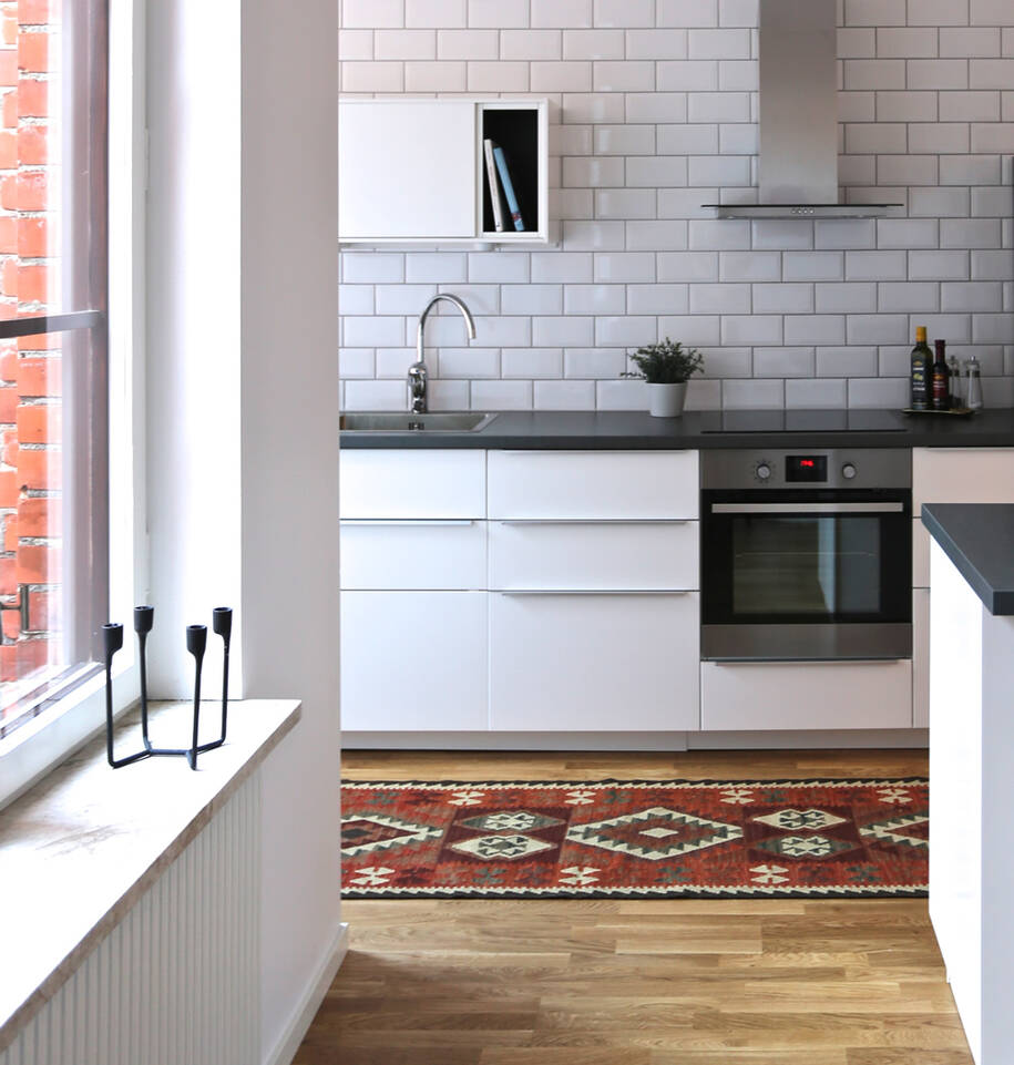 Red runner kilim afghan old style -  Carpet in a kitchen.
